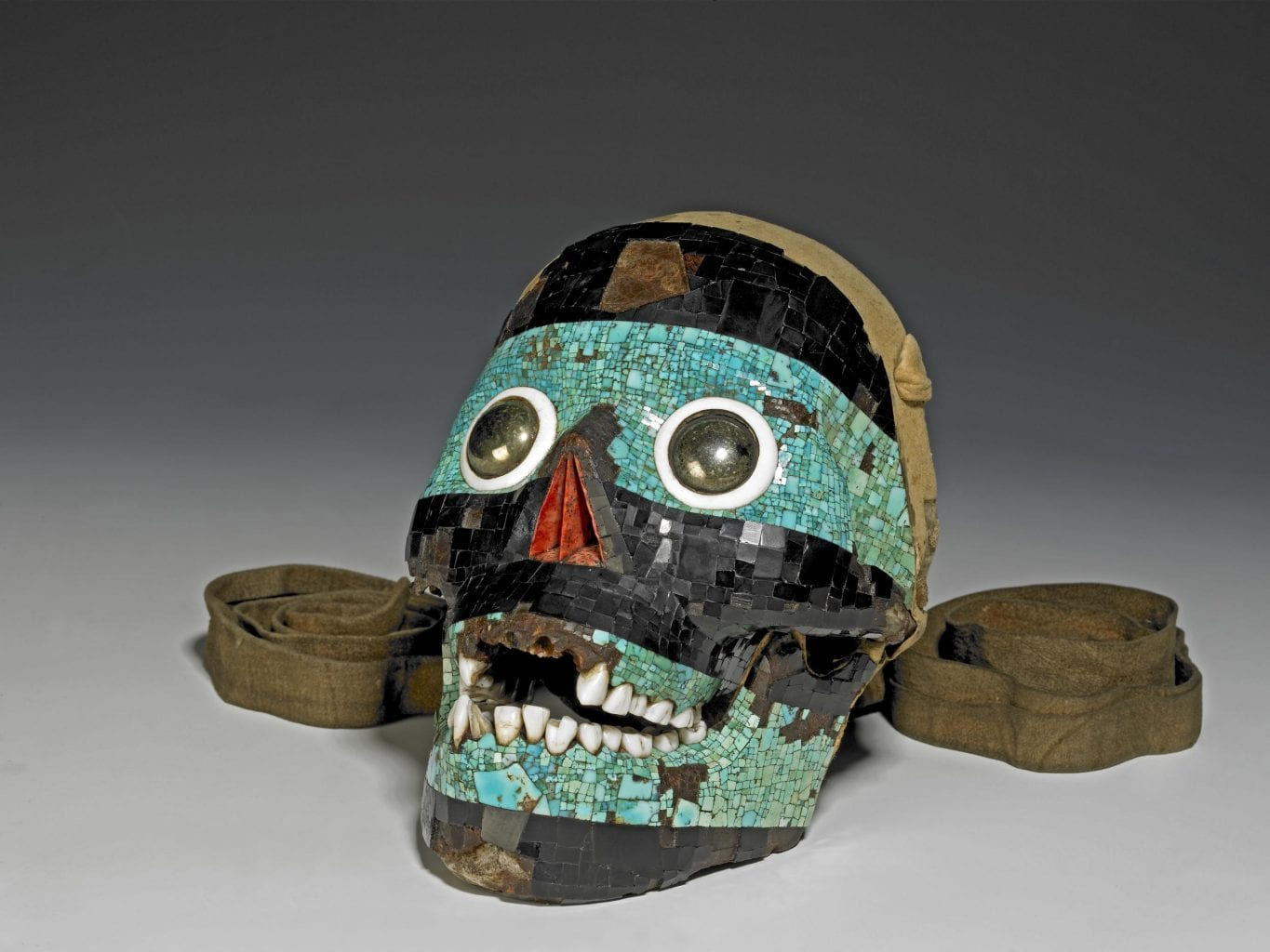 Experts believe this decorated human skull is a depiction of the Mesoamerican deity Tezcatlipoca. Credit: British Museum