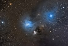 This image show two spectacular reflection nebulae are in the constellation Corona Australis. They are the result of a few very bright stars in a large, dusty cloud. This area is 500 light years from Earth. Shutterstock.