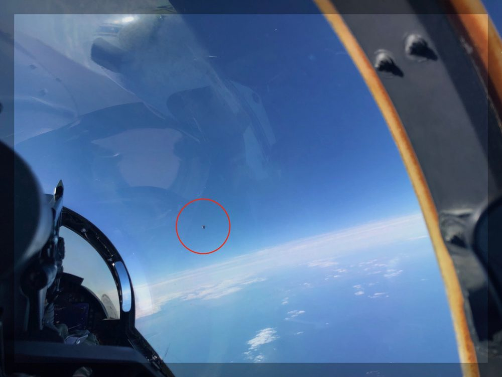 This image, snapped by a US Navy Pilot, shows the UFO circled in red. Image Credit: The Debrief.