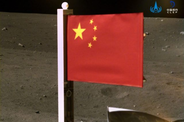 A photograph from the Chang'e 5 lander-ascender of the Chinese flag on the Moon. Credit: CNSA/CLEP
