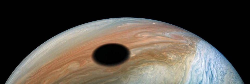 The shadow of Io, one of Jupiter's spectacular moons. Credit: NASA/Juno Image Gallery