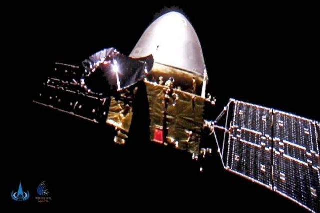 """Real photo of Tianwen-1 published by the Chinese Agency. The photos were obtained using a microprobe with a camera, which was specially released from the board of """"Tianwon 1"""" to shoot from the side. These are probably the first pictures of a spacecraft taken during its journey to the Red Planet! Credit: CNSA"""