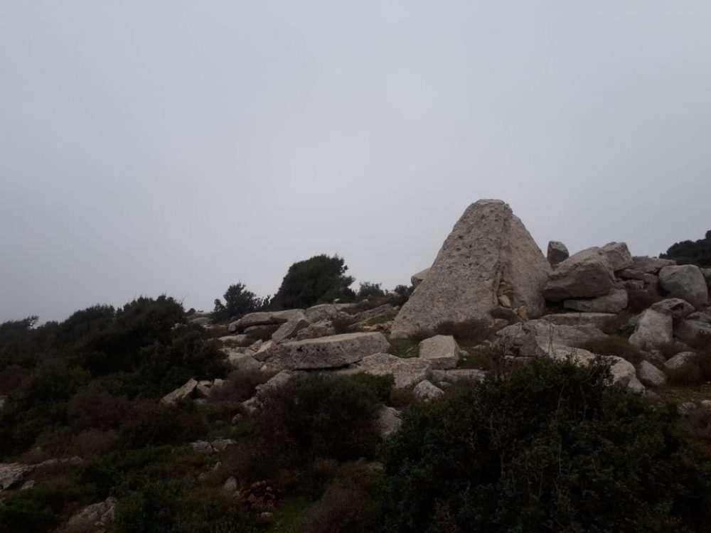 The top of the newly discovered pyramid in Lebanon can be seen amongst the stones in near-perfect condition. Credit: The961