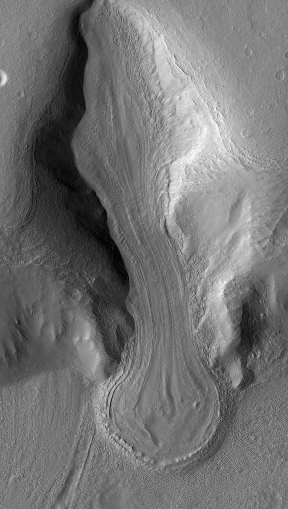 A massive well-preserved glacier on Mars photographed by the Mars Reconnaissance Orbiter spacecraft. Scientists now know that these massive glaciers on Mars did not form during a single ice age. Credit: NASA/ JPL/ University of Arizona/ Arizona State University.