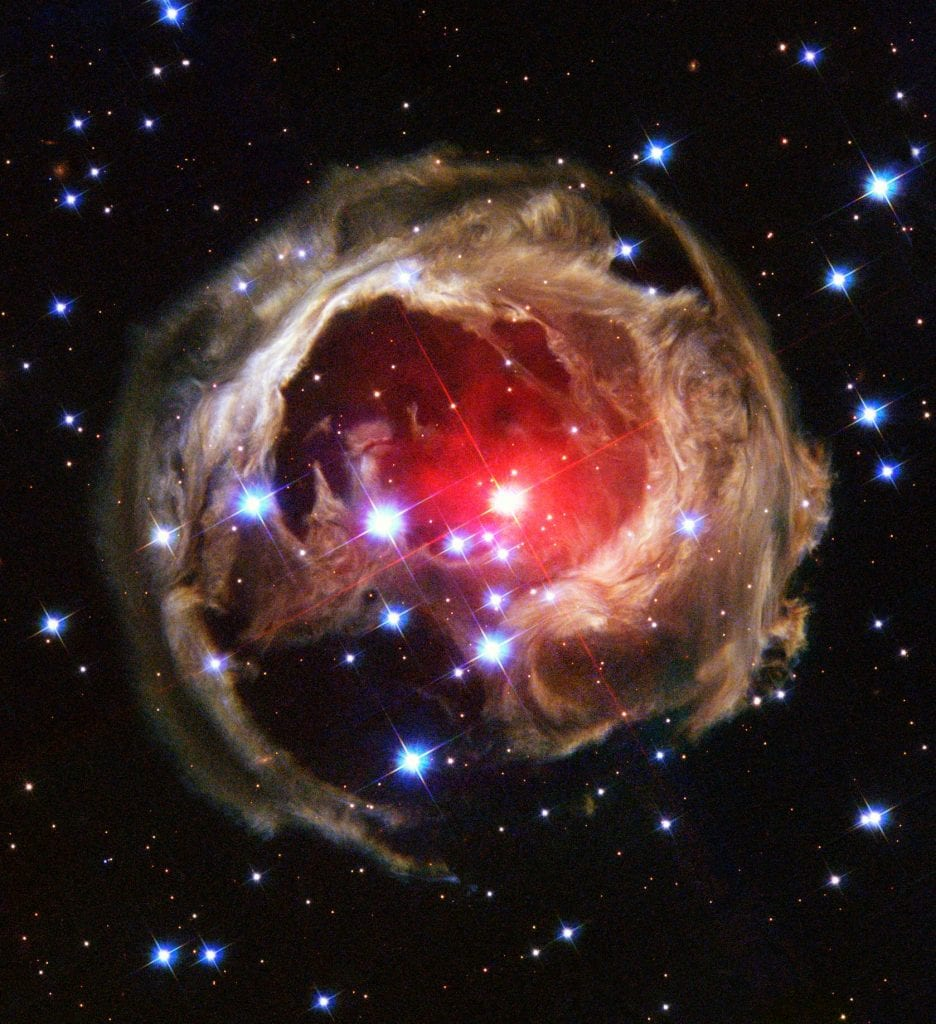This Hubble image shows the expanding halo of light around V838 Monocerotis, a star located 20,000 light-years away from Earth. Credit: NASA and The Hubble Heritage Team (AURA/STScI)