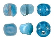 These blue glass beads are now considered the oldest European goods in America. Credit: (M. L. Kunz et al. / American Antiquity)