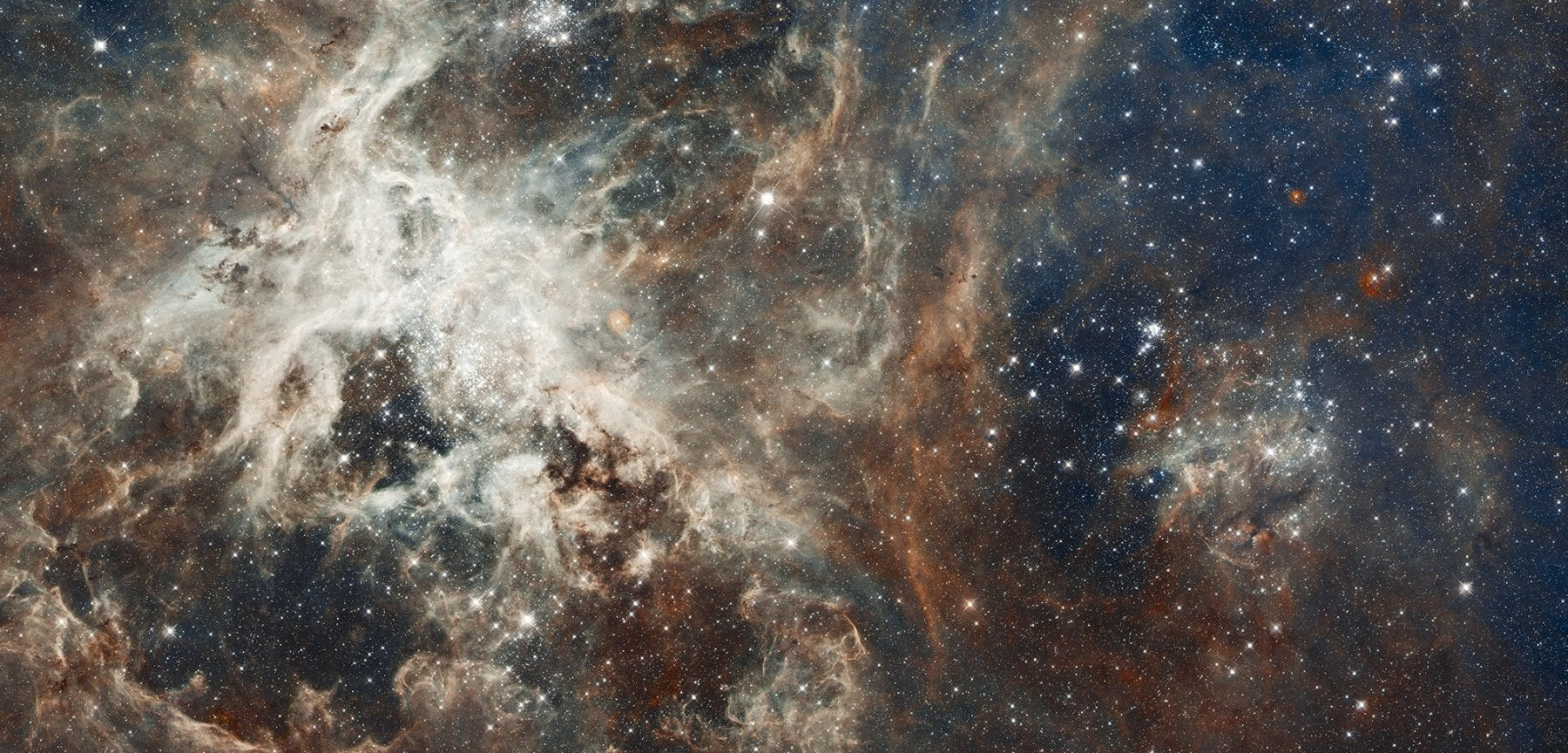 Near-infrared view of 30 Doradus, more commonly known as the Tarantula Nebula. Credit: NASA, ESA, and E. Sabbi (STScI)