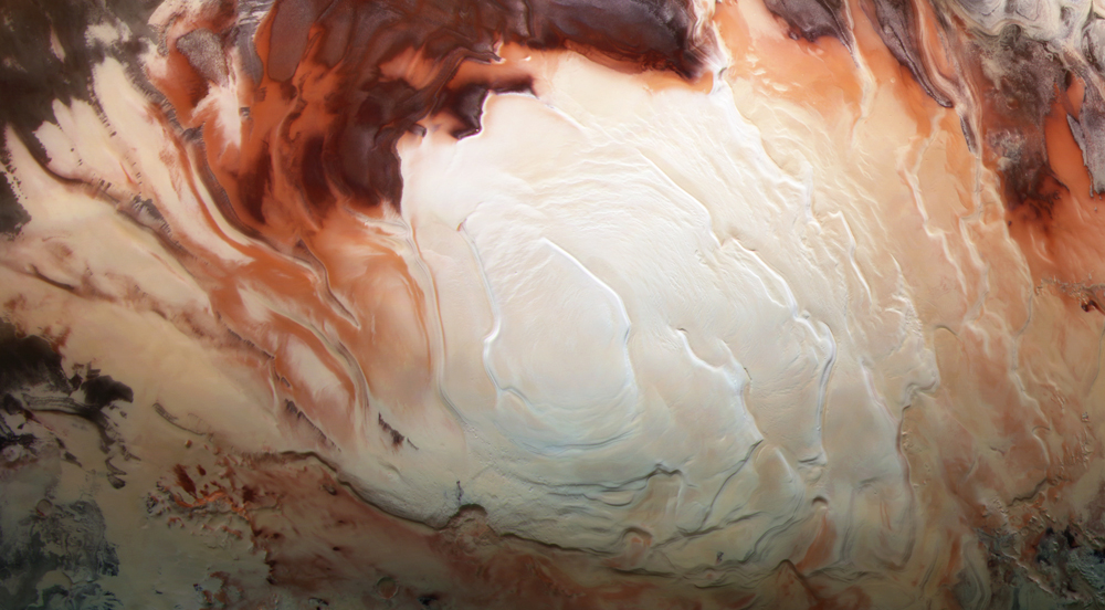 An image of Mars's south pole ice cap made from several blue, green, and infrared images by ESA's Mars Express Orbiter. This is one of the images that prove there is a lot more ice on Mars than previously thought. Credit: ESA