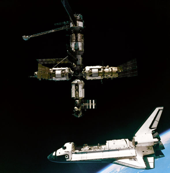 "Coupling of the shuttle ""Atlantis"" with the orbital station ""Mir"". Credit: NASA"