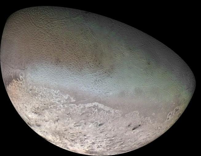 Color mosaic of Triton made from footage of Voyager 2. Credit: NASA/JPL/USGS