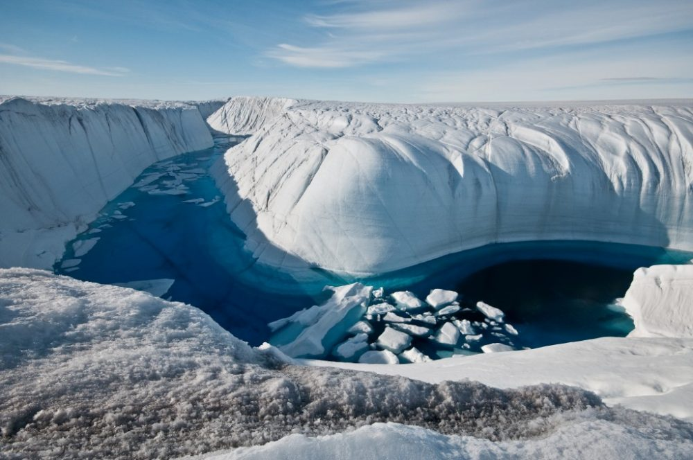 Greenland's kilometer-deep ice cover hides many secrets. Who knows what will be discovered if the ice melts entirely as it has happened in the past. Credit: Ian Joughin, UW APL Polar Science Center
