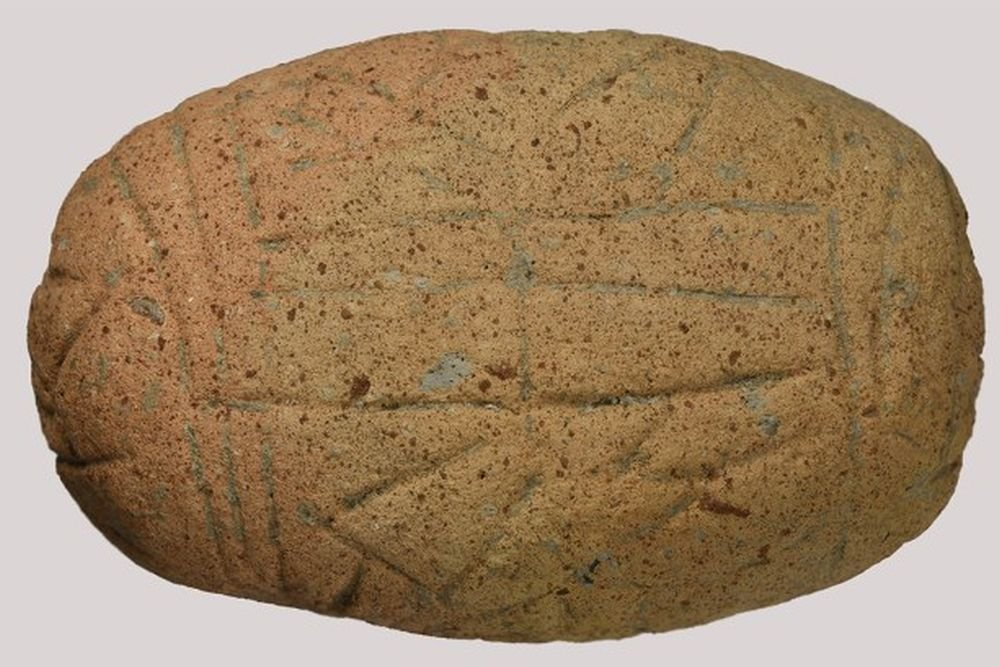 Here is the newly found clay tablet in Bulgaria. It is about 7000 years old and has been carved in a mystery language. Credit: National Institute and Museum of Archaeology