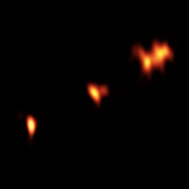A snapshot of the three components of quasar PJ352-15. Credit: Momjian, et al / B. Saxton (NRAO / AUI / NSF)