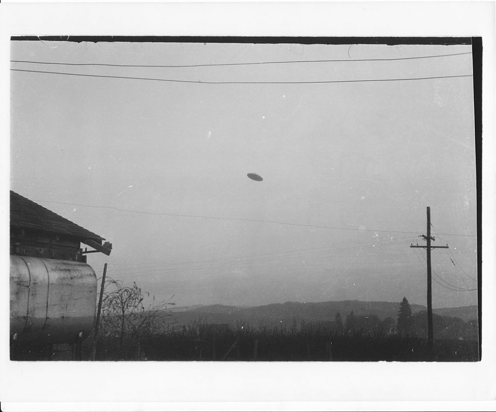 One of the controversial McMinnville UFO phogoraphs taken by a couple in 1950. How many UFO sightings do you think have been reported in the past? Hundreds of thousands maybe? Credit: Wikimedia Commons