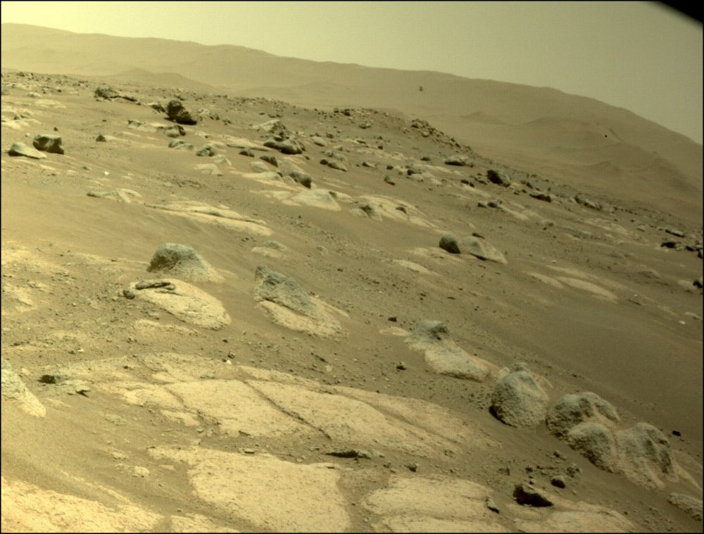 Photo of Ingenuity taken by the rover during the fourth flight. Credit: NASA / JPL-Caltech