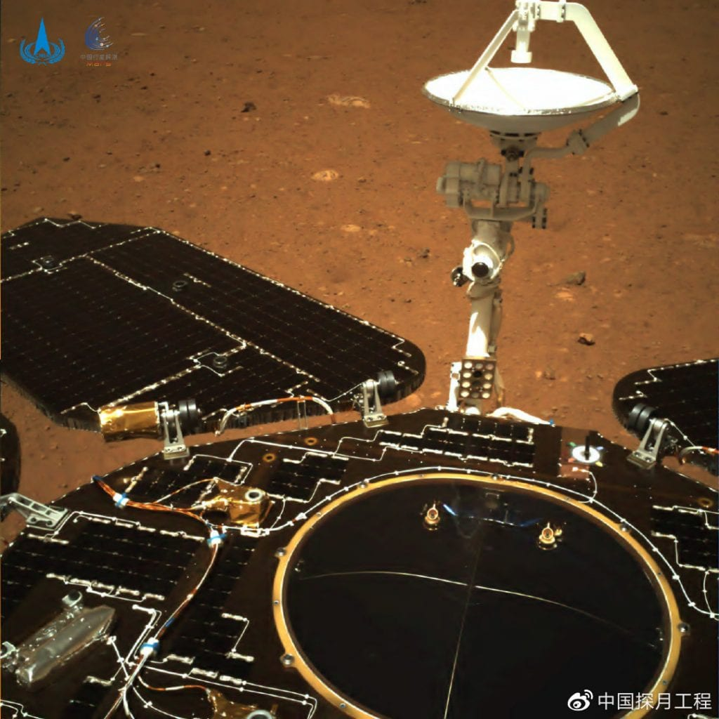 One of the images of Mars taken by the rear camera of China's rover. The antenna of the rover and its solar panels are visible. Credit: CNSA / PEC