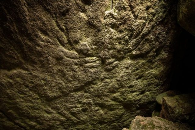 The head of the deer and its antlers are visible in this ancient rock painting. Credit: Historic Environment Scotland