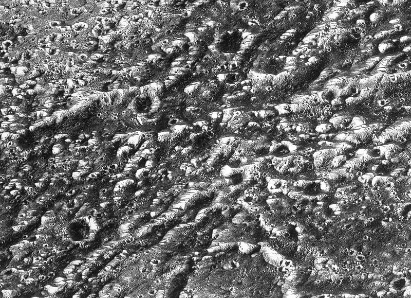This photo of Ganymede's surface, taken by the Galileo mission in 1996, shows the moon's characteristic wide ridges and densely spaced craters. This implies that the surface has been unchanged for billions of years. Credit: NASA / SCIENCE PHOTO LIBRARY