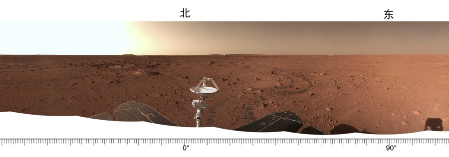 This is a panorama of the surrounding area. on which you can see the landing platform, and a snapshot of the tracks from the rover wheels. It was shared with the new sound recordings from the Zhurong rover on Mars. Credit: CNSA