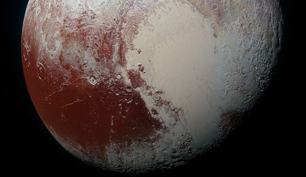 The largest of the red spots on Pluto can be seen on the left - Cthulhu Macula. Credit: NASA/JHUAPL/SwRI