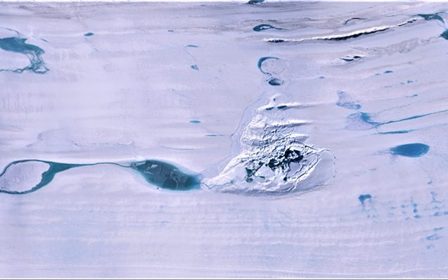 In the center is the fractured ice of the valley on the Аmery Ice Shelf where once used to be a massive lake. It is surrounded by other lakes with meltwater. Credit: NASA ICESat-2