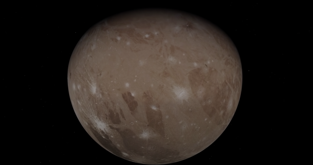 A screenshot of the video showing Juno's view of Ganymede. Image Credit: Juno Mission / YouTube.