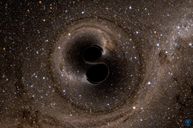 Scientists have confirmed Hawking's theory about black holes. The image is from a computer simulation showing the collision of two black holes that produce gravitational waves. Credit: Simulating eXtreme Spacetimes (SXS) project / Courtesy of LIGO