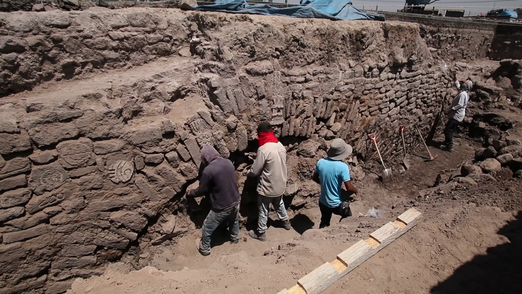 Archaeologists working at the site of the 600-year-old Aztec tunnel. Credit: INAH