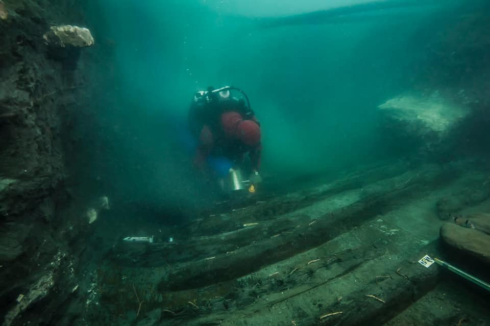 An underwater archaeologist exploring the shipwreck at the bottom of the sunken city. Image Credit:Ministry of Tourism and Archaeology.