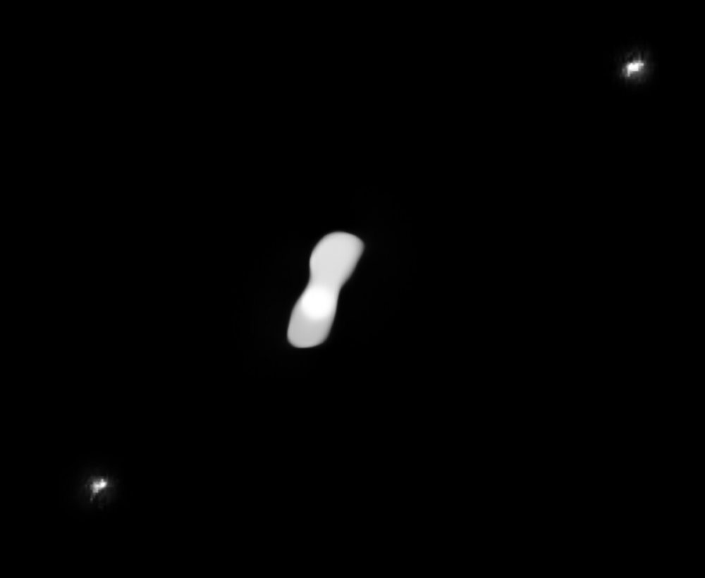 Dog-bone asteroid 216 Kleopatra and its two satellites. Credit: ESO / Vernazza, Marchis et al. / ONERA, CNRS